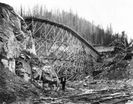 [Partially constructed trestle and flume across spillway cut of Coquitlam Dam]