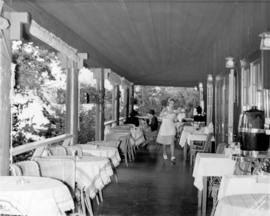[Waitress serving in] Cliffhouse [verandah restaurant]