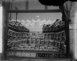 [Storefront window of N. Caple and Co. Stationers at 546 Granville Street, displaying copies of t...