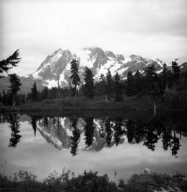 [Unidentified mountain and reflection in lake]