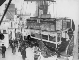 Loading [London Omnibus] on ship in London