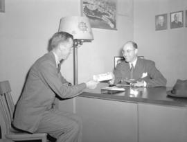 Mr. Gundry [receiving ticket for Trans Canada Airlines'] round the world trip