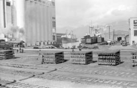 [Ships docked near grain elevator]