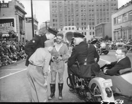 Clowns and policemen in 1953 P.N.E. Opening Day Parade