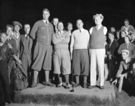 Golf Match - Tommy McAuliffe, armless golfer in night foursome with Harry Winder against Dave Bla...