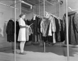 [Woman in fur storage vault at Nelsons Laundry]