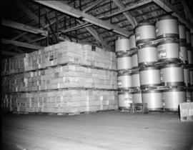 [Newsprint and other products in the Evans, Coleman, and Evans Ltd. storage warehouse]