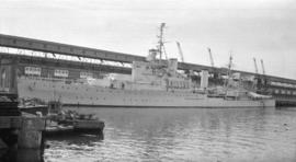 H.M.S. Kenya [at dock]