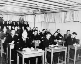 Academy attending lectures [view of uniformed men in a classroom]
