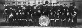 [Group portrait of Mount Pleasant Band assembled outside New City Market before first parade]