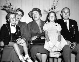 P.N.E. director D.H. Collister sitting with ladies and children