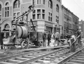 [Construction of street railroad along Granville Street at Georgia Street]