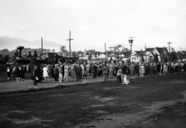 [Crowds at Kitsilano Beach celebrating the 60th anniversary of the arrival of C.P.R. locomotive #...
