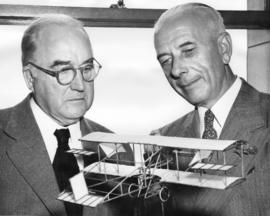 [Major J.S. Matthews and William Templeton with the model airplane that Mr. Frank H. Ellis built ...