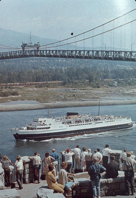 [View from Stanley Park of a] vessel passing under[neath the] Lions Gate [First Narrows] Bridge