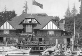 [A four-oared crew in the water in front of the Vancouver Rowing Club]