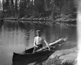[Man in a canoe]