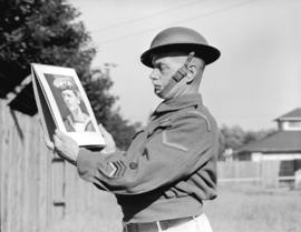 Veteran looking at [picture of] sailor son