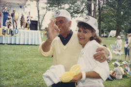 Unidentified man and woman wearing Chevron hats