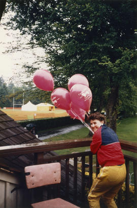 Woman with Canada Day balloons on Brockton Clubhouse deck