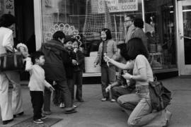 Susan Gam and Keeman Wong interviewing children on Pender Street
