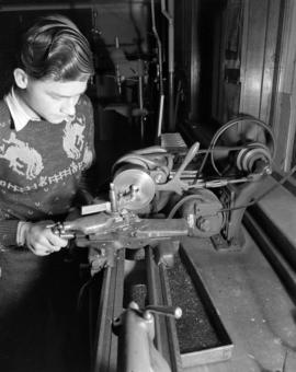 Boy learning [to operate] lathe [at] Pacific Mills