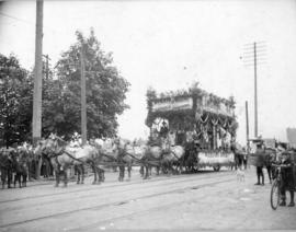 [Webster Brothers Groceries and Provisions float]