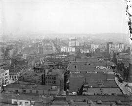[View of rooftops and buildings along Hastings and Cordova Streets, looking east from Cambie Street]