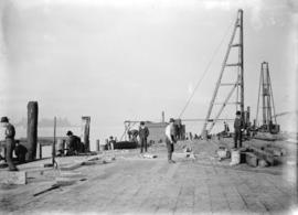 [Men working on construction at Evans, Coleman and Evans dock]