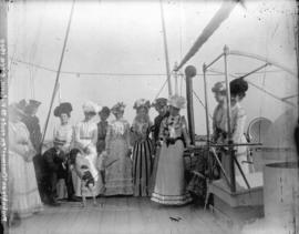 [Women's field hockey team, in formal dress, on deck of ferry to Victoria]