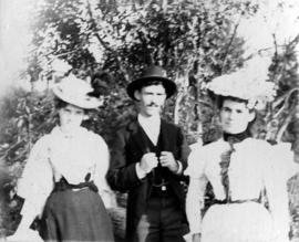 [Unidentified man with two women]