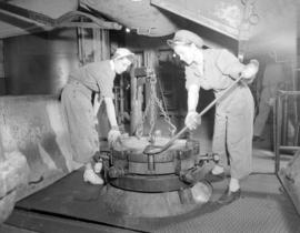 [Two women operating a machine at] Pacific Mills