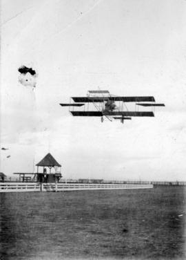 [Airplane in flight over Minoru Race Track]