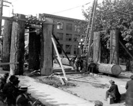 Lumberman's Arch under construction, Pender Street near Hamilton