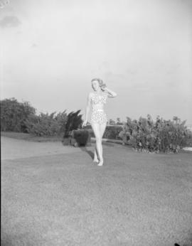 [Woman modeling a bathing suit on the grounds of the Royal Vancouver Yacht Club]