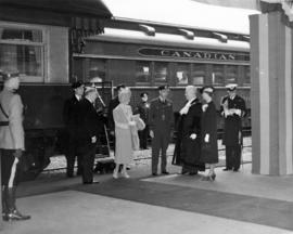 [King George VI and Queen Elizabeth being greeted by Mayor and Mrs. Telford at the C.P.R. Station]