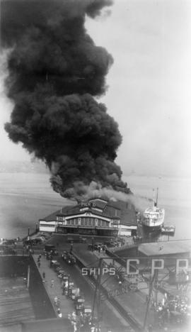 "[Pier D fire with C.P.R. vessel ""Princess Charlotte"" beginning to move away from dock]"