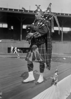 [Bagpiper playing, Caledonian Games, Athletic Park]