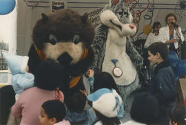 Tillicum and wolf mascot on the Chevron Stage at Playland for Tillicum's birthday party