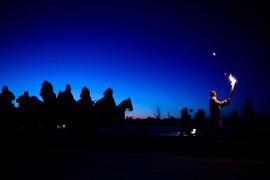 Day 72 Torchbearer 6 Alexander Miller carries the flame followed by 28 horses in Sioux Valley Dak...