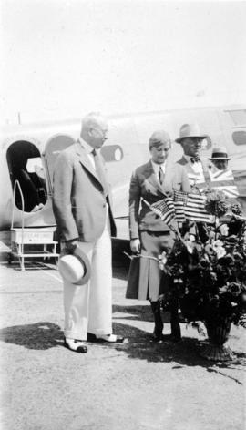 [Stewardess Dorethea Bow and L.D. Taylor at Sea Island Airport for the opening of the United Airl...