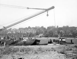 [McKenzie Bardge and Derrick Company Limited dredging False Creek for a new water main near the f...