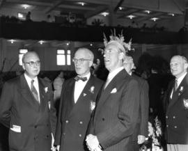 J.C. Hackney, P.N.E. President J.S.C. Moffitt, unidentified guest, and Vice-President W.J. Borrie...