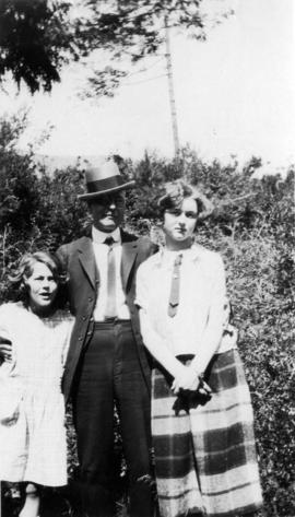 [L.D. Taylor standing outside with two girls]