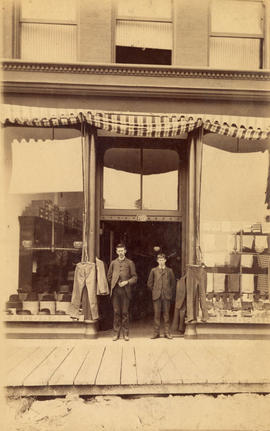 [George Robertson Gordon in front of his mens' wear store at 107 Carroll Street]