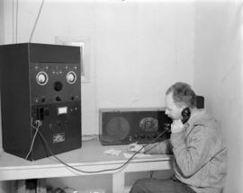 [Man using Canadian Marconi radiophone at] Sandspit [on the] Queen Charlotte Islands