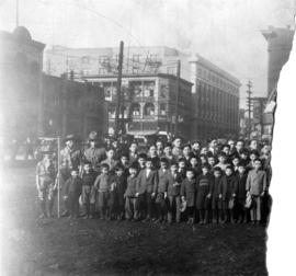 [Group photograph of boys and young men on Pender Street]