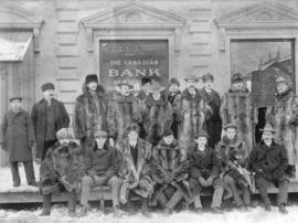 [Staff outside the Canadian Imperial Bank of Commerce]