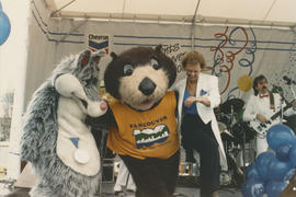 Wolf mascot, Tillicum and performer on the Chevron Stage at Playland for Tillicum's birthday party