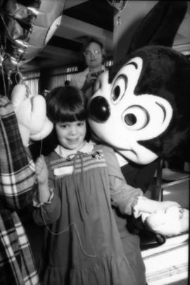 Mickey Mouse and child